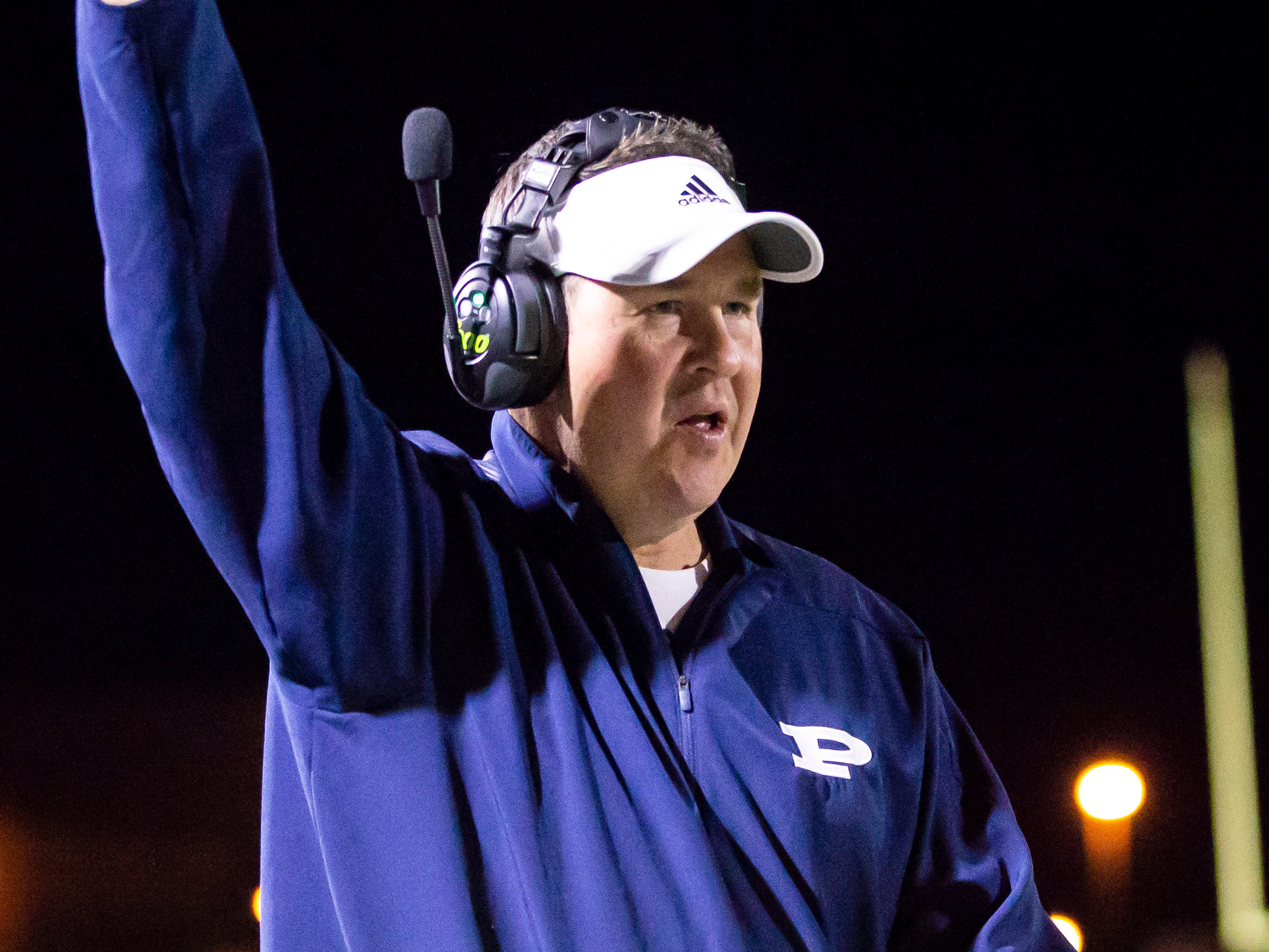 Kicking coach Eric Aardahl motions following a touchdown during the playoff game against the Red Mountain Mountain Lions at Pinnacle High School on Friday, November 9, 2018 in Phoenix, Arizona. #azhsfb