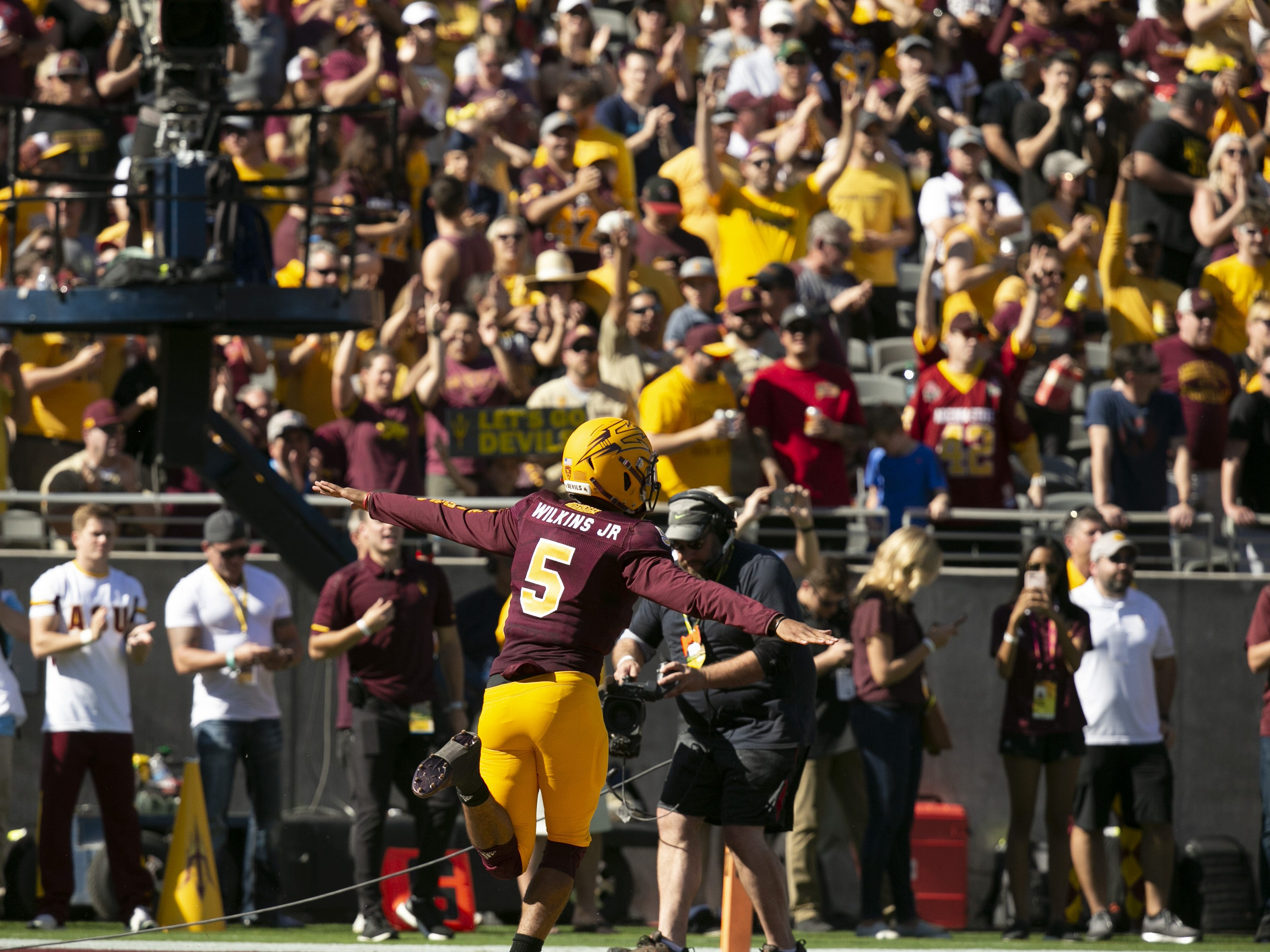 ASU quarterback Manny Wilkins after scoring touchdown during the second quarter of the PAC-12 college football game against UCLA at Sun Devil Stadium in Tempe on Saturday, November 10, 2018.