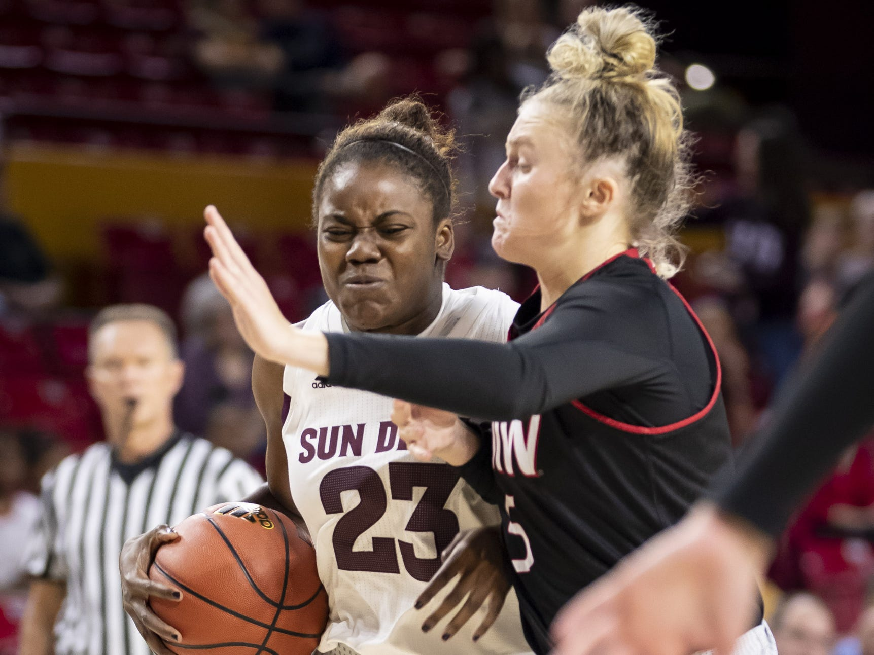 Forward Iris Mbulito (23) of the Arizona State Sun Devils drives to the basket against guard Kara Speer (5) of the Incarnate Word Cardinals at Wells Fargo Arena on Tuesday, November 6, 2018 in Tempe, Arizona.