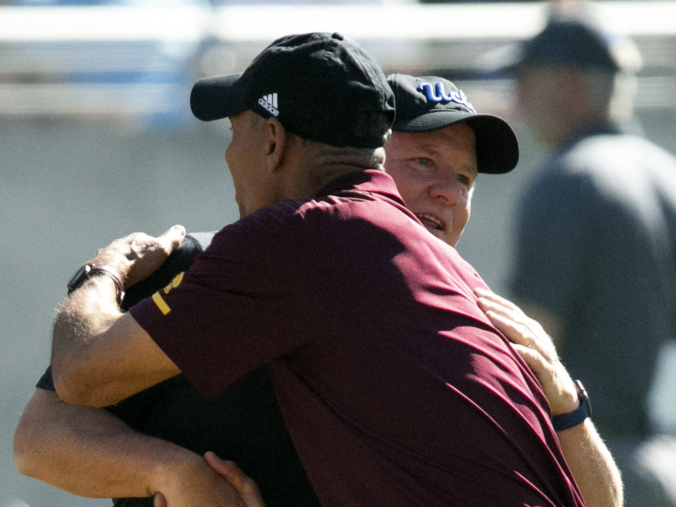ASU head coach Herm Edwards and Chip Kelly embrace before the PAC-12 college football game at Sun Devil Stadium in Tempe on Saturday, November 10, 2018.