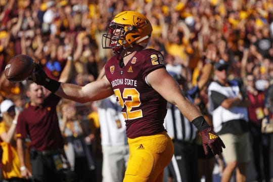 ASU's Nick Ralston (22) celebrates a touchdown against UCLA during the first half at Sun Devil Stadium in Tempe, Ariz. on November 10, 2018.