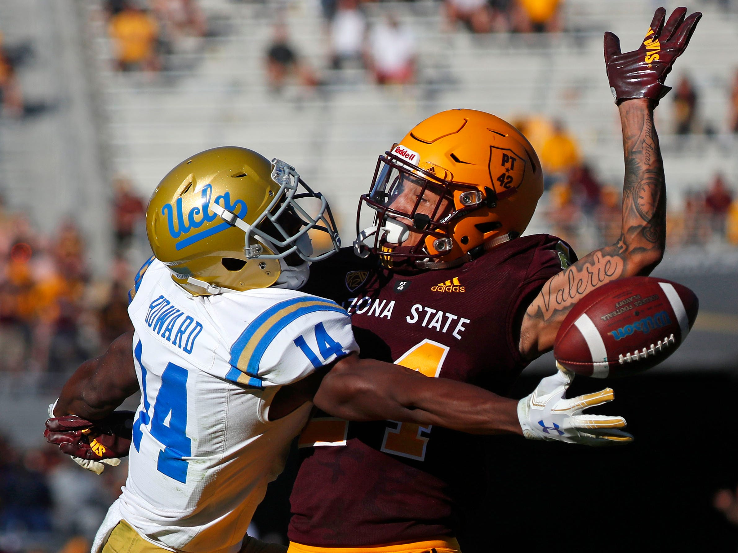 ASU's Chase Lucas (24) is called for pass interference on UCLA's Theo Howard (14) during the second half at Sun Devil Stadium in Tempe, Ariz. on November 10, 2018.