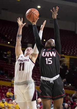 Guard Robbi Ryan (11) of the Arizona State Sun Devils and forward Starr Omozee (15) of the Incarnate Word Cardinals reach for a rebound at Wells Fargo Arena on Tuesday, November 6, 2018 in Tempe, Arizona.