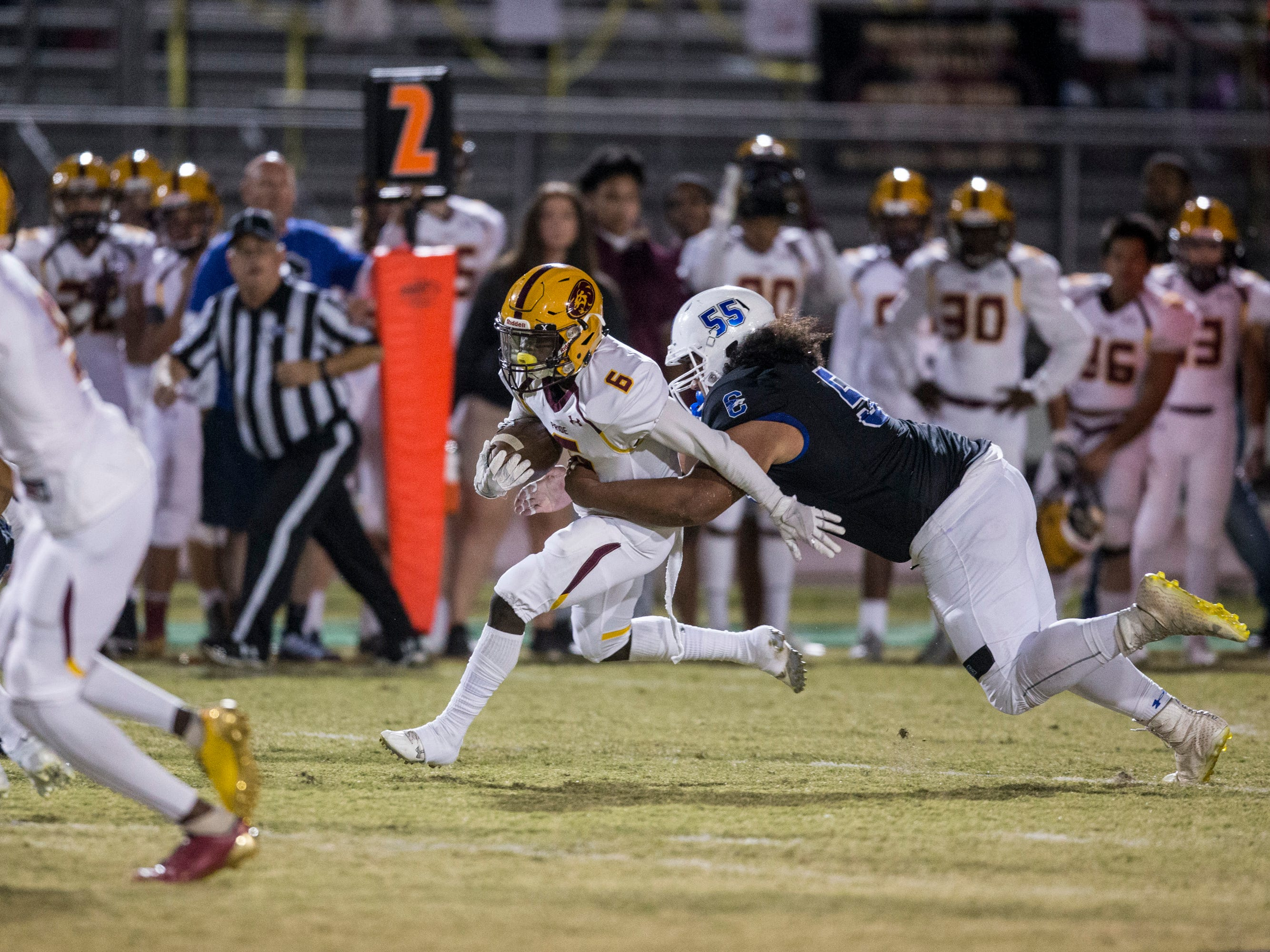 Mountain Pointe's Jathan Washington runs after a catch against Chandler in the first half on Friday, Nov. 9, 2018, at Chandler High School in Chandler, Ariz.