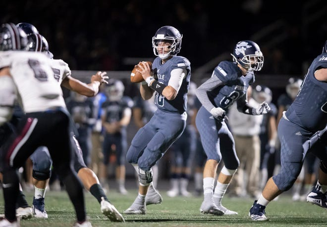 Junior quarterback Jd Johnson (10) of the Pinnacle Pioneers looks to throw against the Red Mountain Mountain Lions during the playoff game at Pinnacle High School on Friday, November 9, 2018 in Phoenix, Arizona. #azhsfb