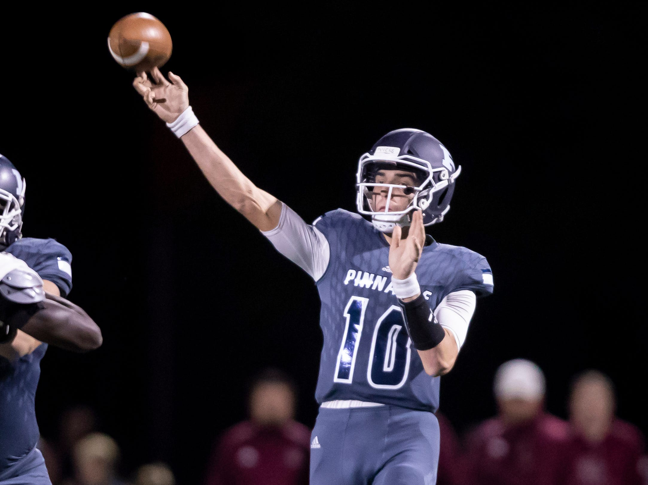Junior quarterback Jd Johnson (10) of the Pinnacle Pioneers throws a pass during the playoff game against the Red Mountain Mountain Lions at Pinnacle High School on Friday, November 9, 2018 in Phoenix, Arizona. #azhsfb