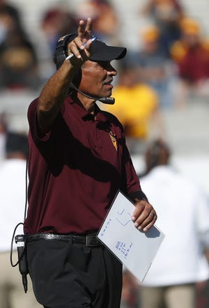 ASU's head coach Herm Edwards points to the scoreboard arguing the time left before a timeout against UCLA during the first half at Sun Devil Stadium in Tempe, Ariz. on November 10, 2018.