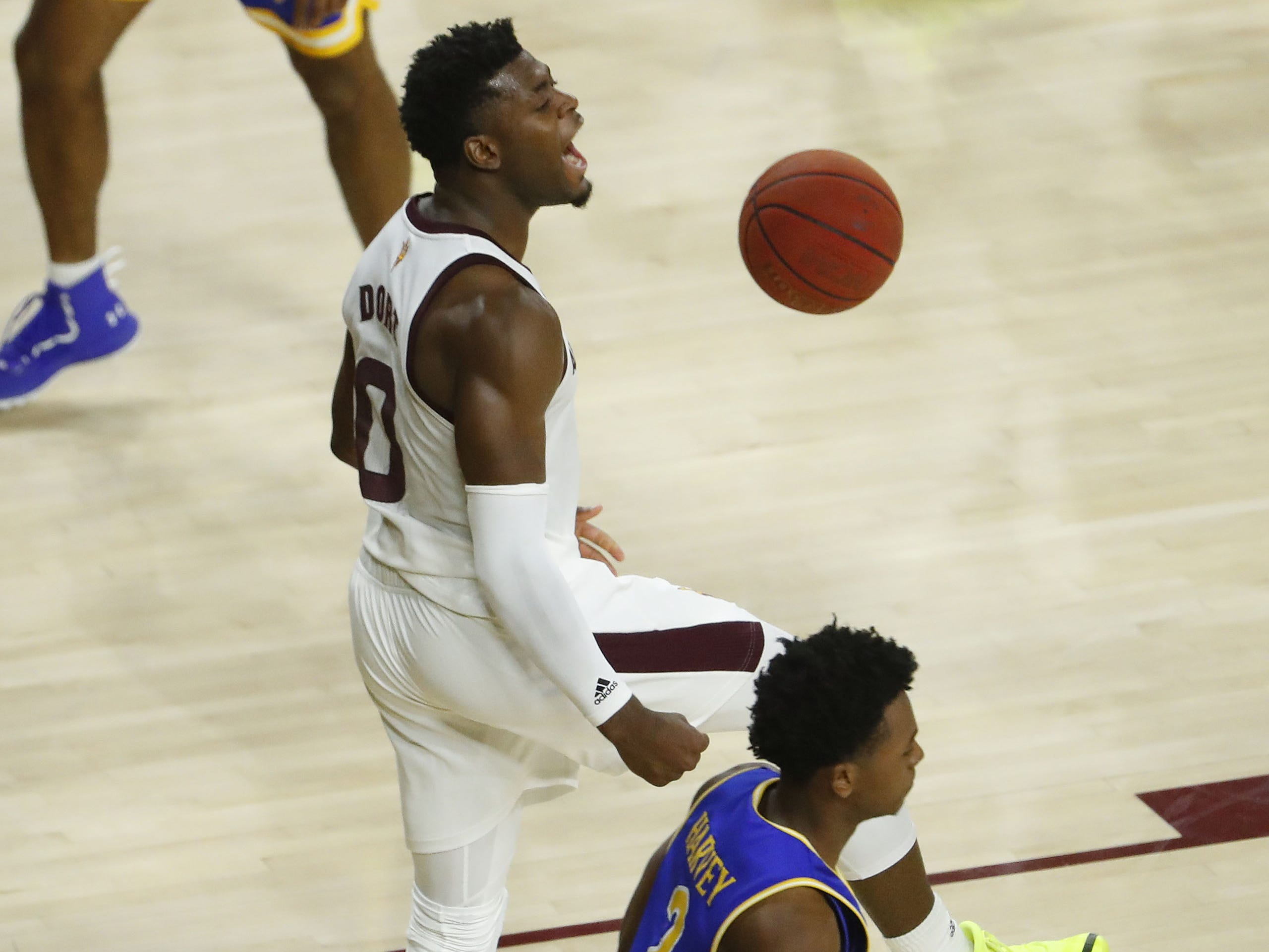 Arizona State's Luguentz Dort (0) dunks the ball against McNeese State during the second half at Wells Fargo Arena in Tempe, Ariz. on November 9, 2018.