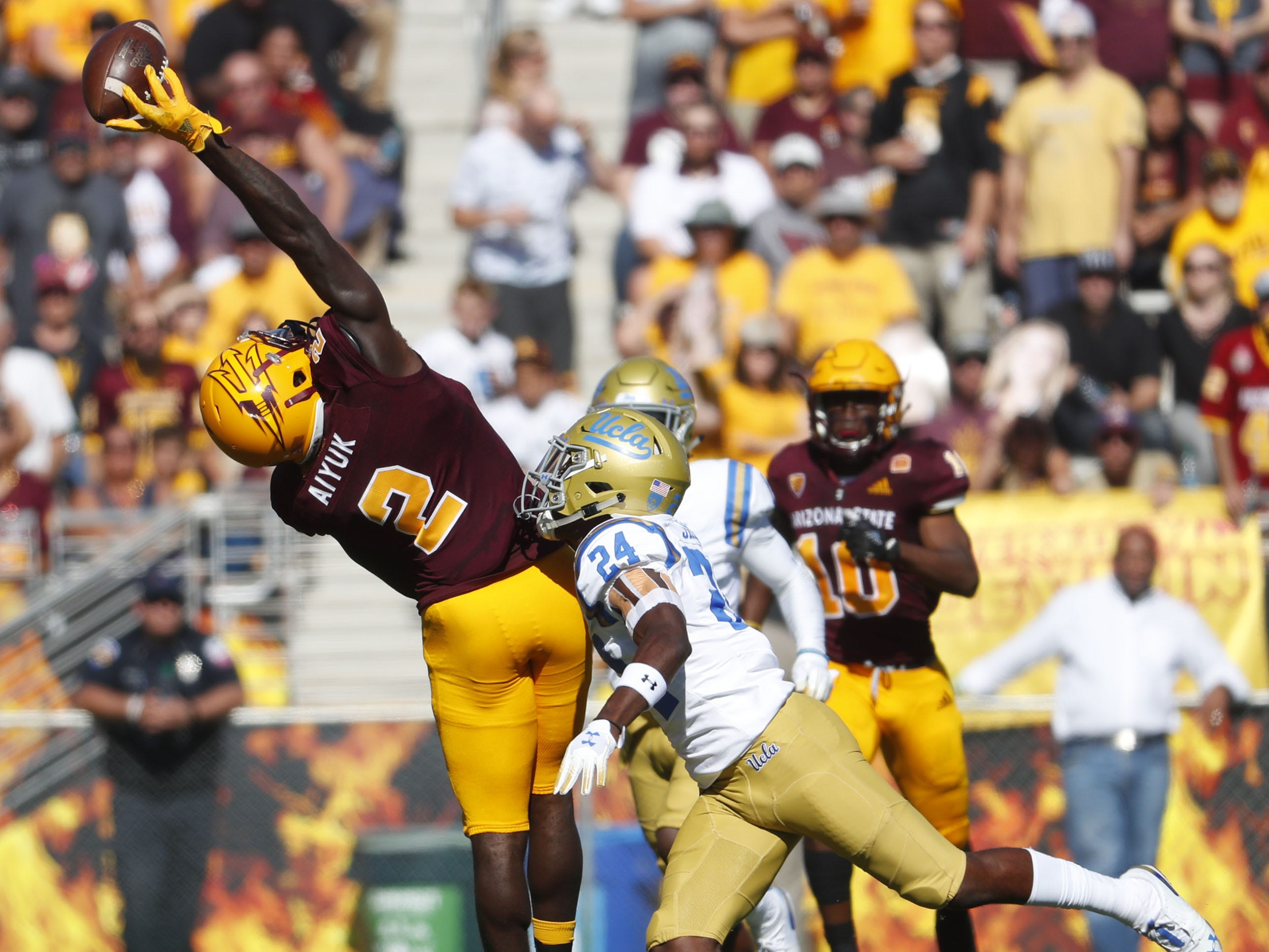 ASU's Brandon Aiyuk (2) attempts to bring in a pass one-handed against UCLA's Jay Shaw (24) during the first half at Sun Devil Stadium in Tempe, Ariz. on November 10, 2018.