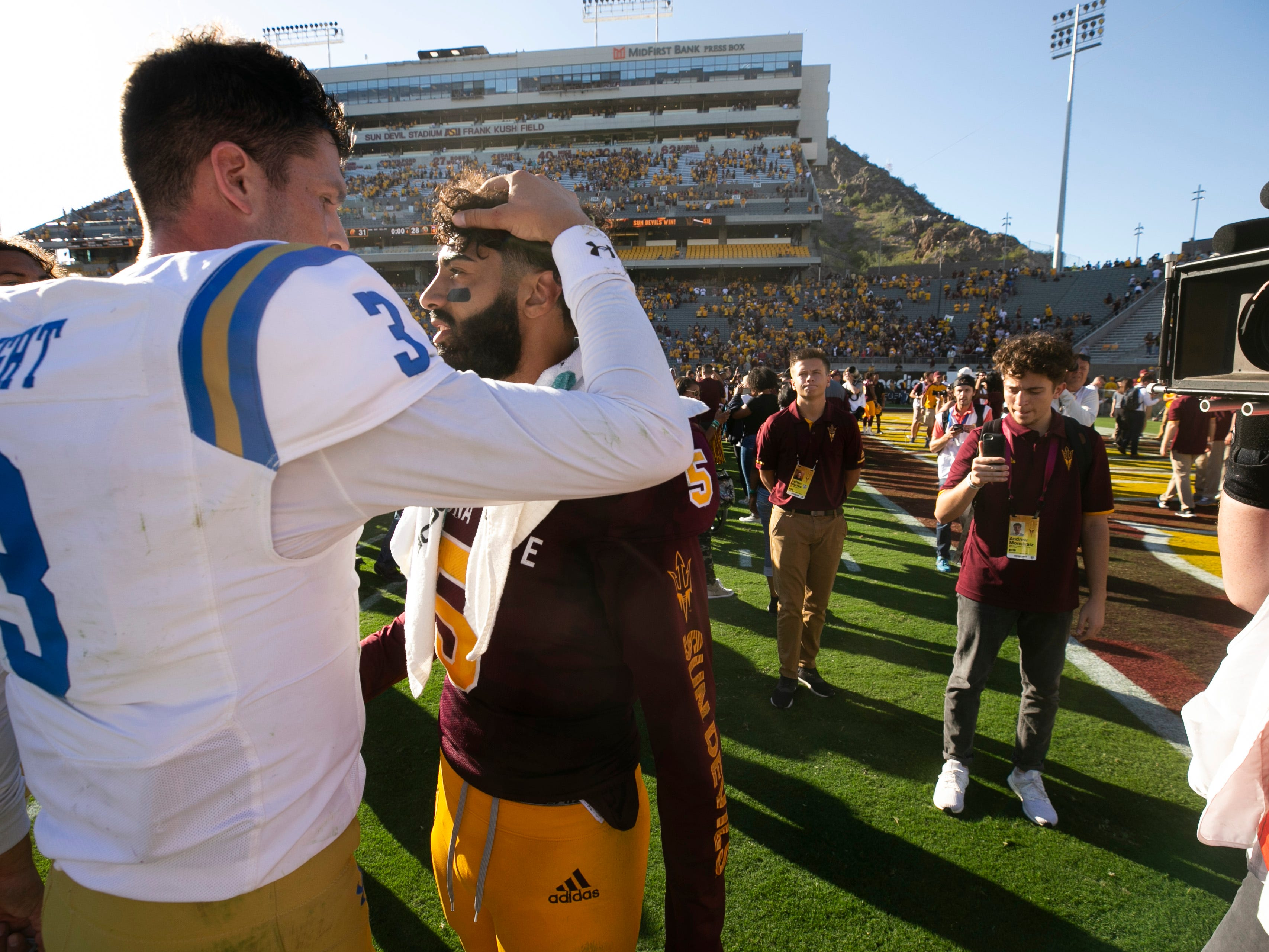 ASU quarterback Manny Wilkins talks to UCLA quarterback Wilton Speight after ASU's 31-28 win over UCLA in the PAC-12 college football game at Sun Devil Stadium in Tempe on Saturday, November 10, 2018. This is the last game at Sun Devil Stadium for Wilkins.
