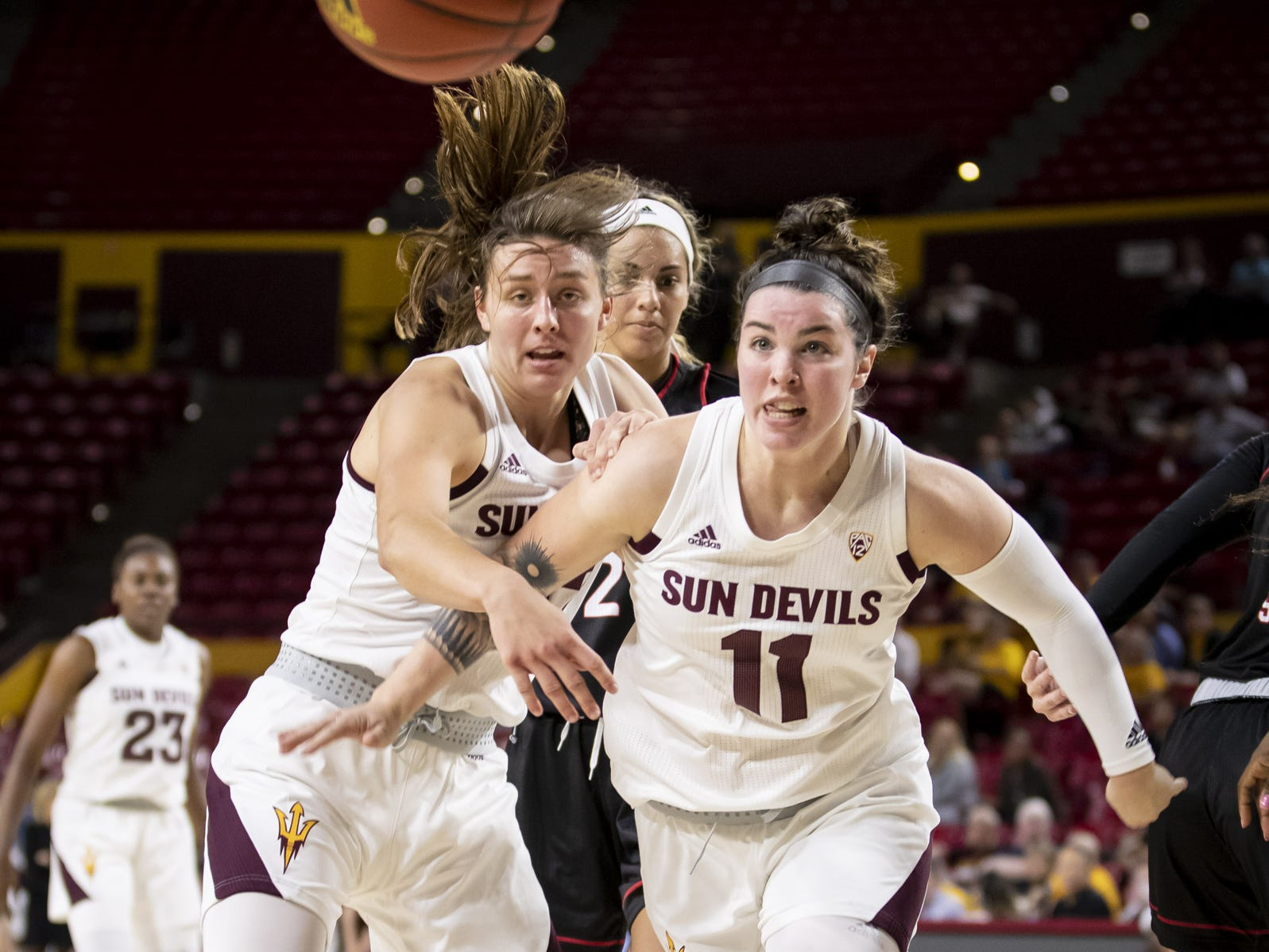 Forward Jayde Van Hyfte (32) and guard Robbi Ryan (11) of the Arizona State Sun Devils run after a loose ball against the Incarnate Word Cardinals at Wells Fargo Arena on Tuesday, November 6, 2018 in Tempe, Arizona.