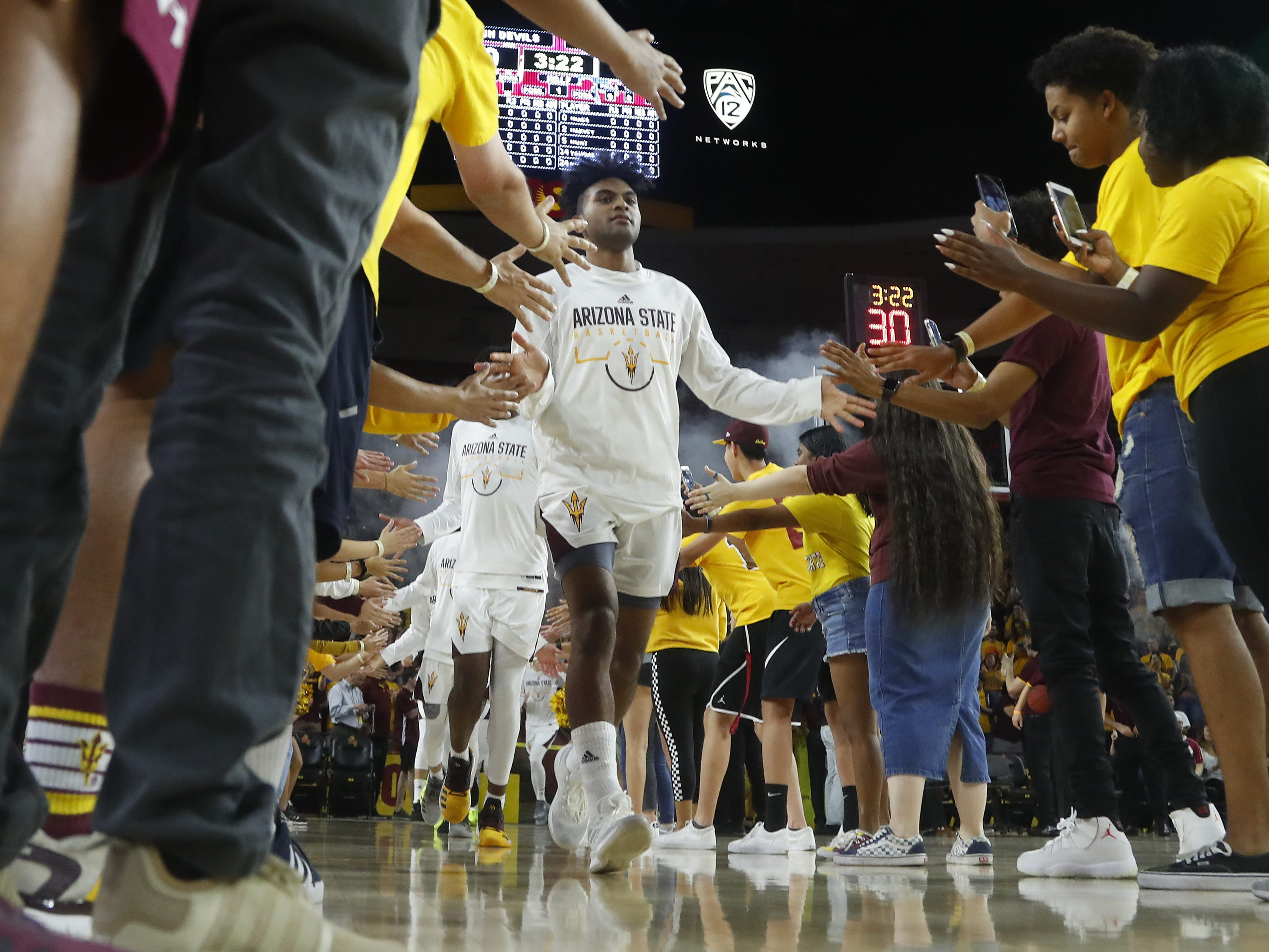 Arizona State's Remy Martin (1) leads the team onto the court during the first half against McNeese State at Wells Fargo Arena in Tempe, Ariz. on November 9, 2018.