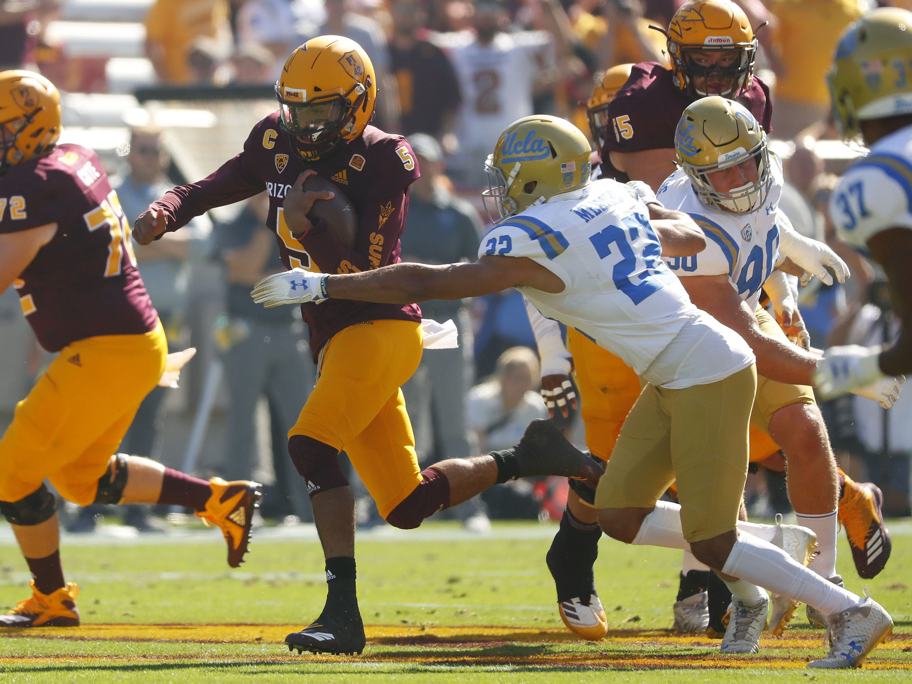 ASU's Manny Wilkins (5) runs downfield against UCLA's Nate Meadors (22) during the first half at Sun Devil Stadium in Tempe, Ariz. on November 10, 2018.