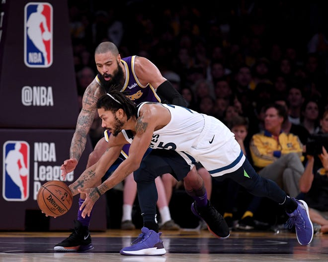 Derrick Rose #25 of the Minnesota Timberwolves regains control of the ball in front of Tyson Chandler #5 of the Los Angeles Lakers during a 114-110 Lakers win at Staples Center on November 7, 2018 in Los Angeles, California.