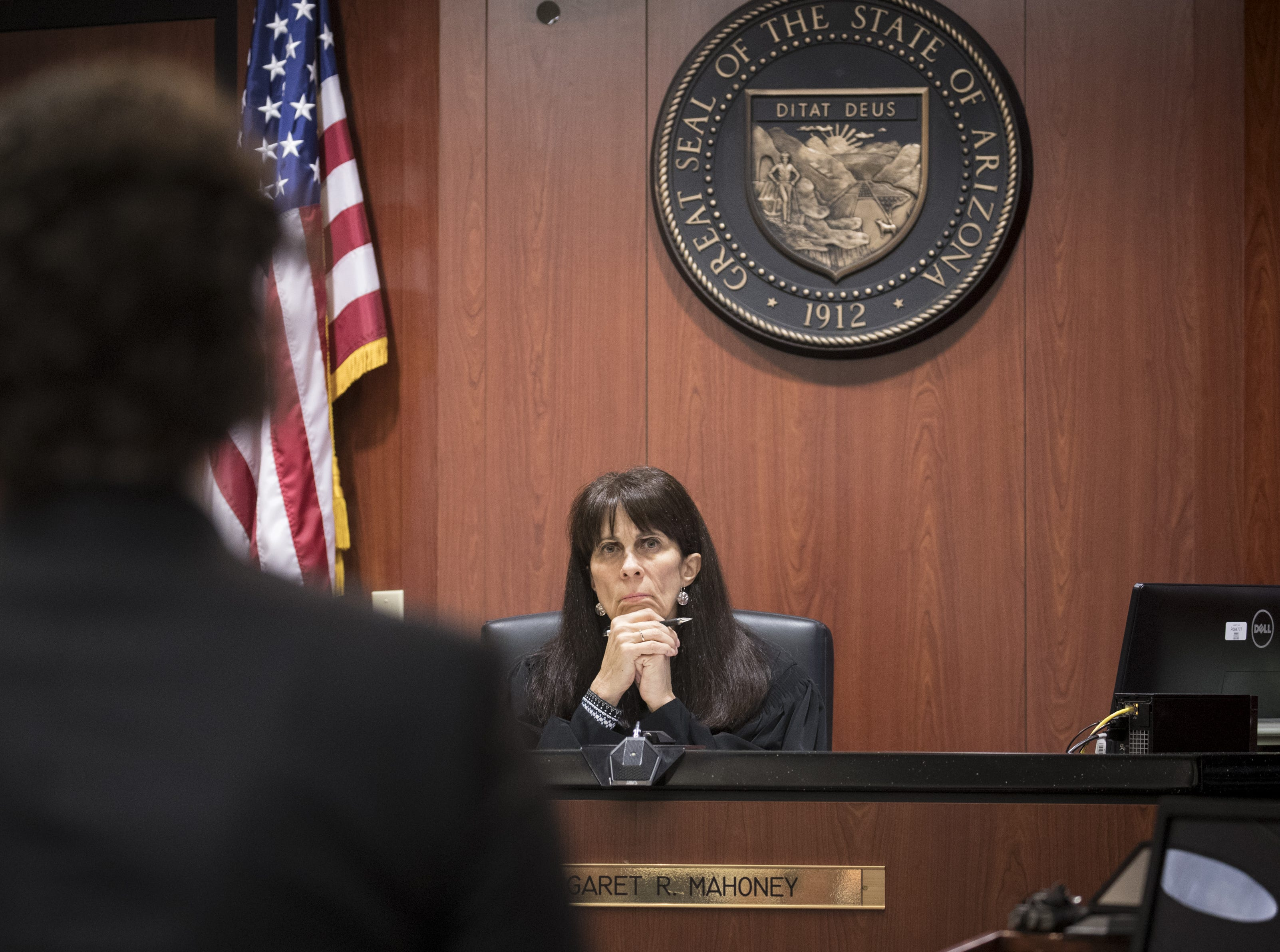 Judge Margaret Mahoney listens during a hearing in her Maricopa County Superior courtroom in Phoenix on Nov. 9, 2018,