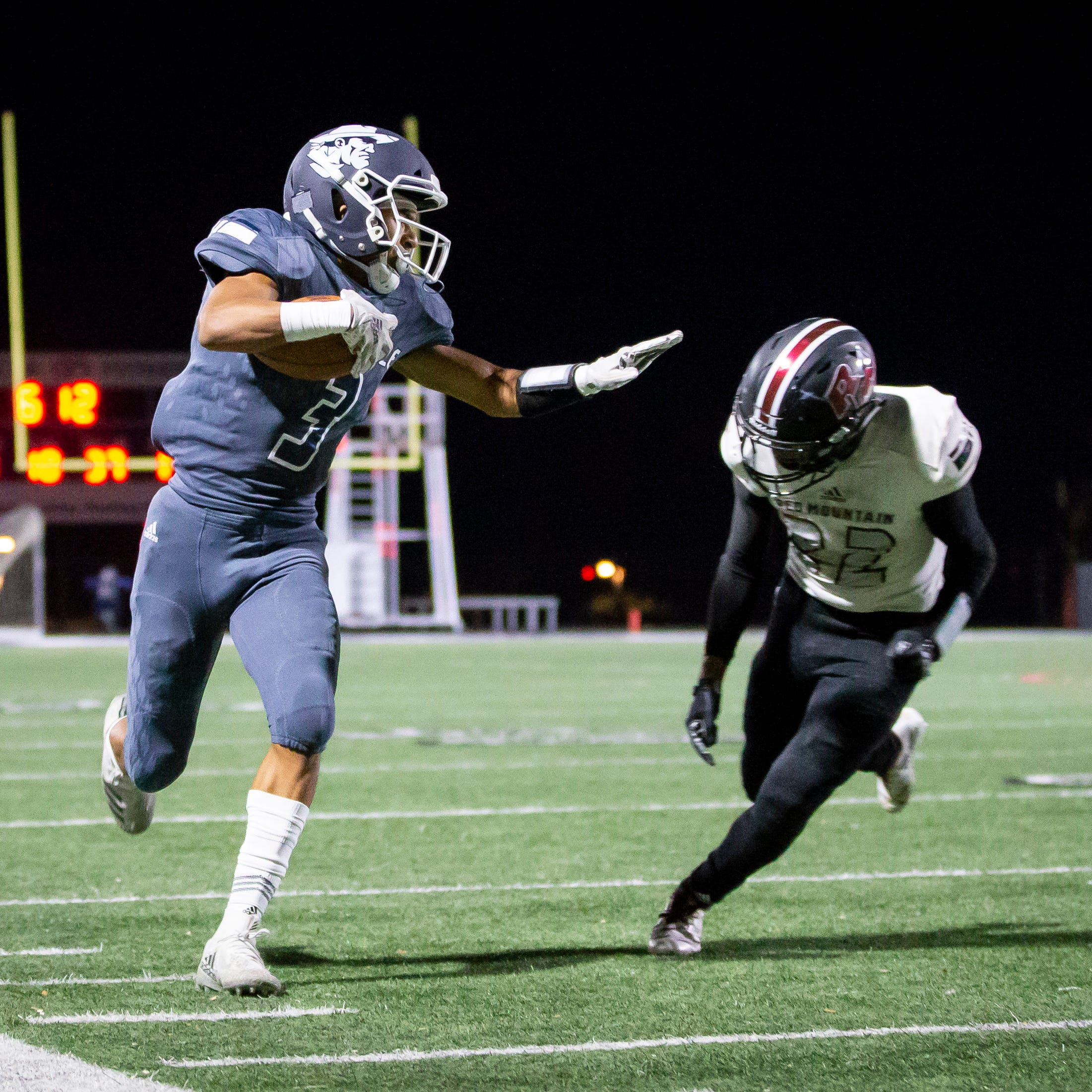 Junior wide receiver Marcus Libman (3) of the Pinnacle Pioneers runs the ball against the Red Mountain Mountain Lions during the playoff game at Pinnacle High School on Friday, November 9, 2018 in Phoenix, Arizona. #azhsfb