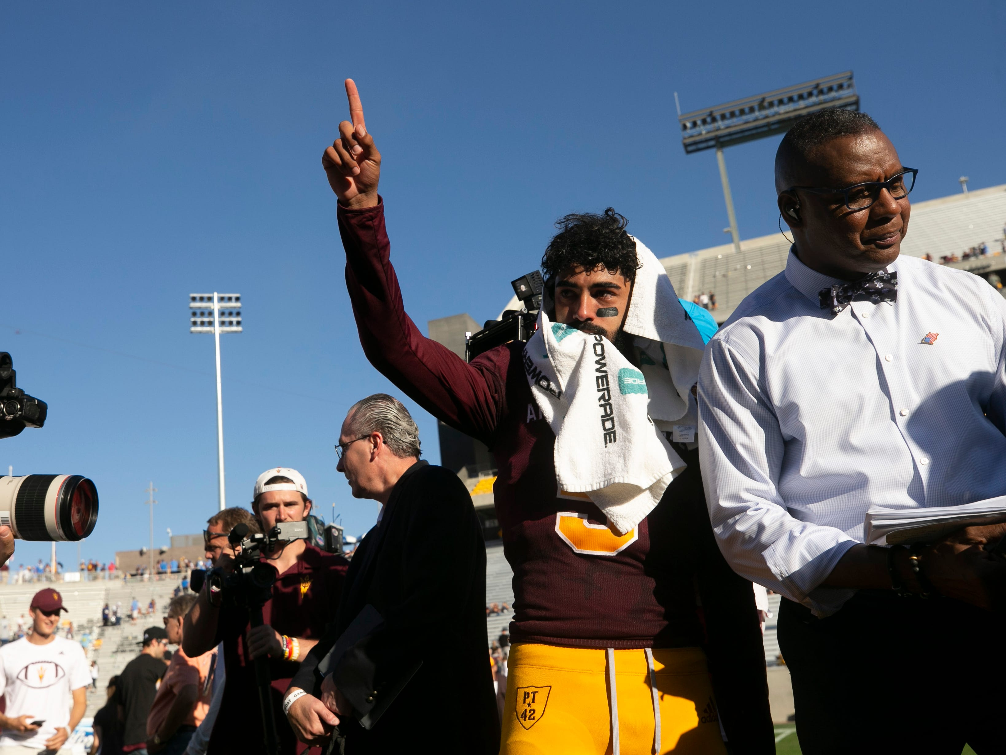 ASU quarterback Manny Wilkins points to the crowd after ASU's 31-28 win over UCLA in the PAC-12 college football game at Sun Devil Stadium in Tempe on Saturday, November 10, 2018. This is the last game at Sun Devil Stadium for Wilkins.