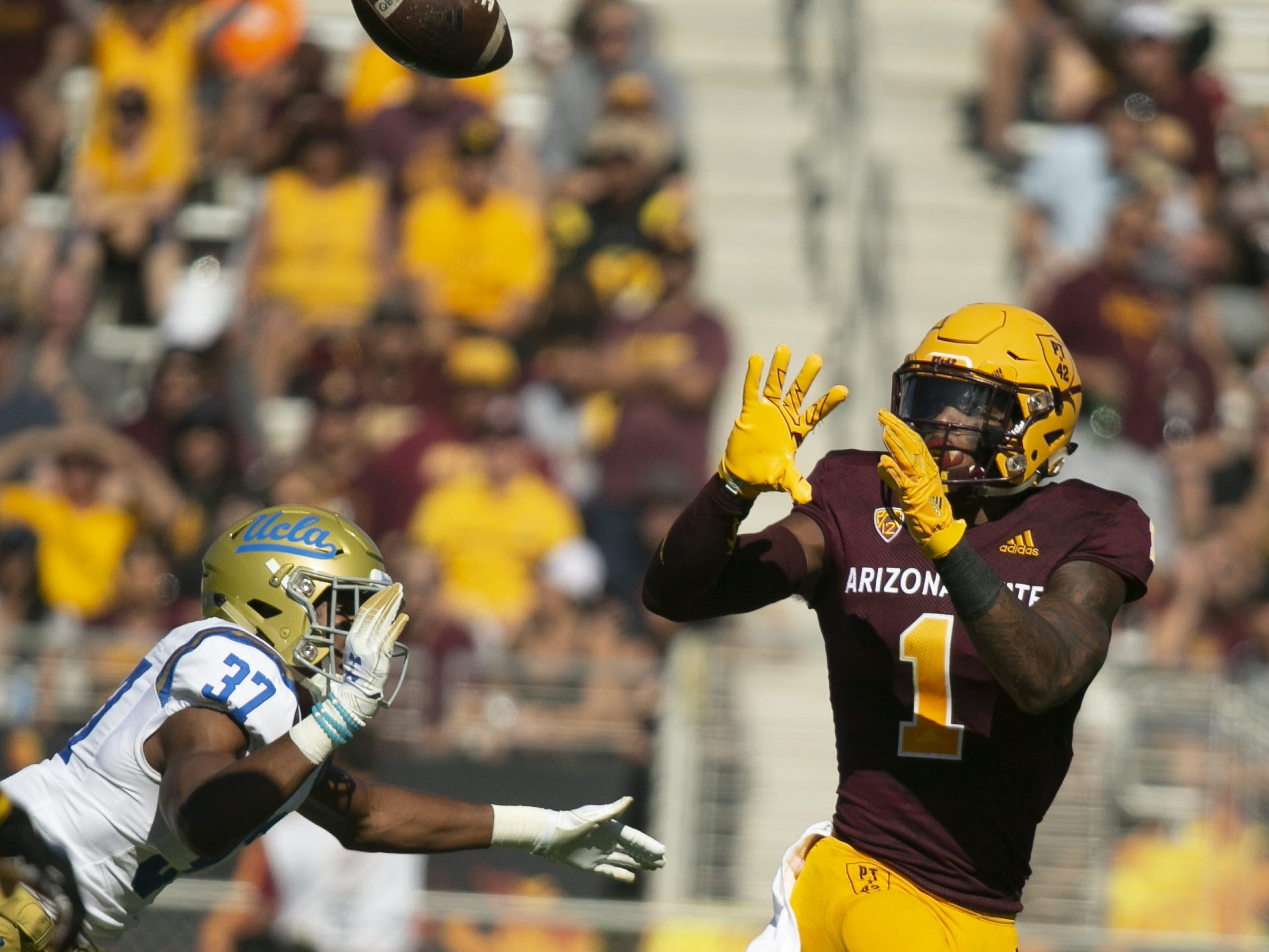 ASU wide receiver N'Keal Harry makes a catch as UCLA safety Quentin Lake defends during the first quarter of the PAC-12 college football game against UCLA at Sun Devil Stadium in Tempe on Saturday, November 10, 2018.