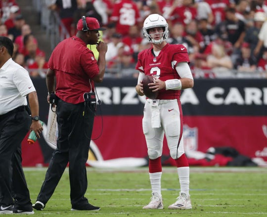 Byron Leftwich talks with Josh Rosen during his first game as Cardinals offensive coordinator.