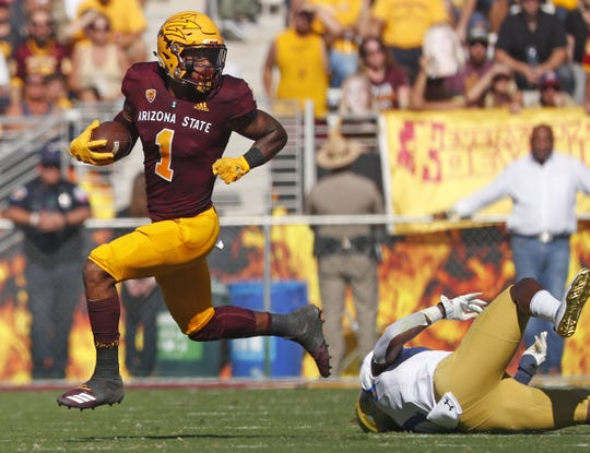 ASU's N'Keal Harry (1) hurdles UCLA's Darnay Holmes (1) during the first half at Sun Devil Stadium in Tempe, Ariz. on November 10, 2018.