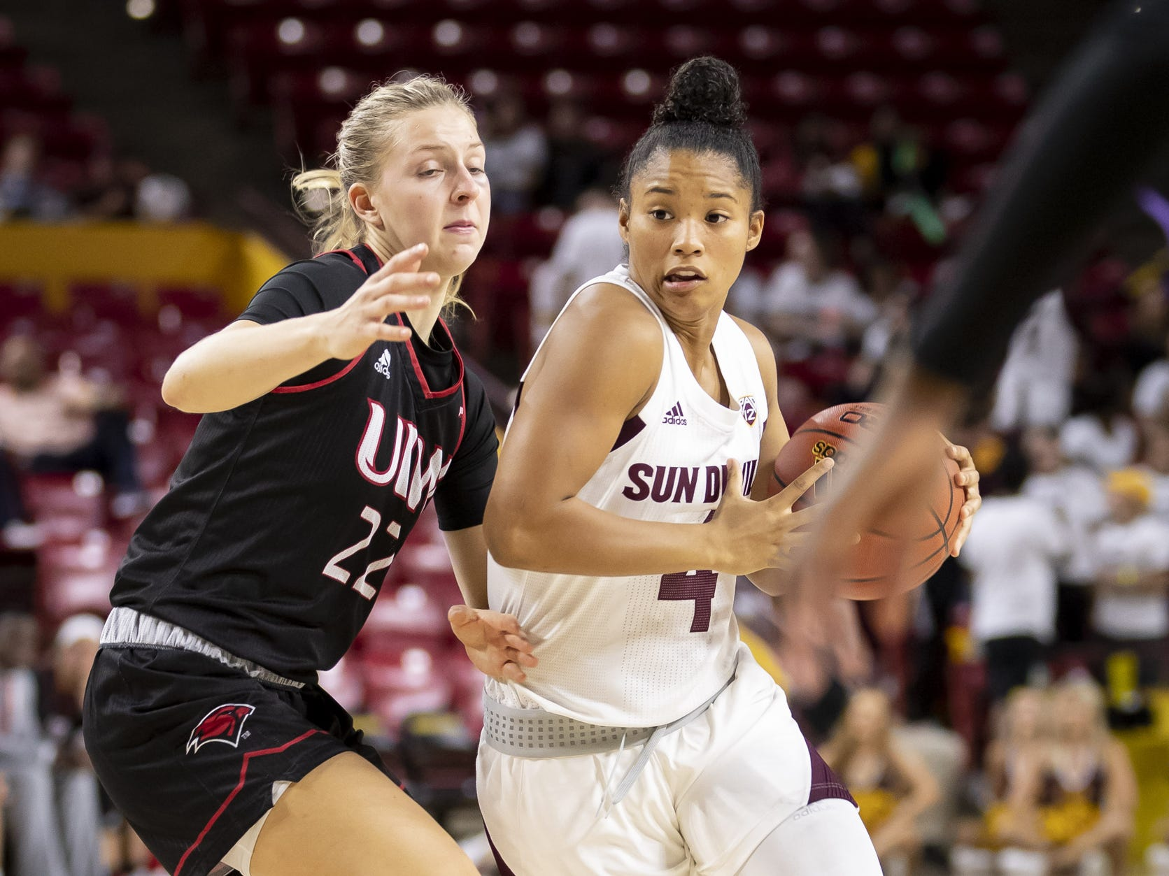 Guard Kiara Russell (4) of the Arizona State Sun Devils drives to the basket against guard Liz Holter (22) of the Incarnate Word Cardinals at Wells Fargo Arena on Tuesday, November 6, 2018 in Tempe, Arizona.