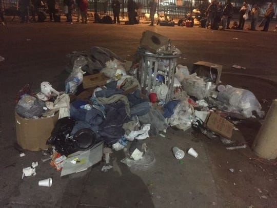 Trash left outside the Human Services Campus in 2017. Father Tom Doyle, who works with the homeless, encourages people to donate directly to agencies like Andre House instead of giving away food or blankets on the street.