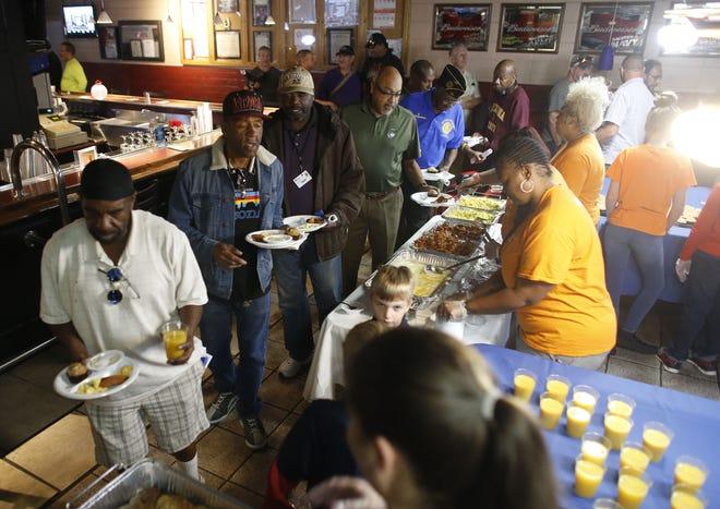 Veterans eat breakfast during 7th annual Forgotten Heroes Appreciation Breakfast at Travis L. Williams American Legion Post 65 in Phoenix on Nov. 10, 2018.