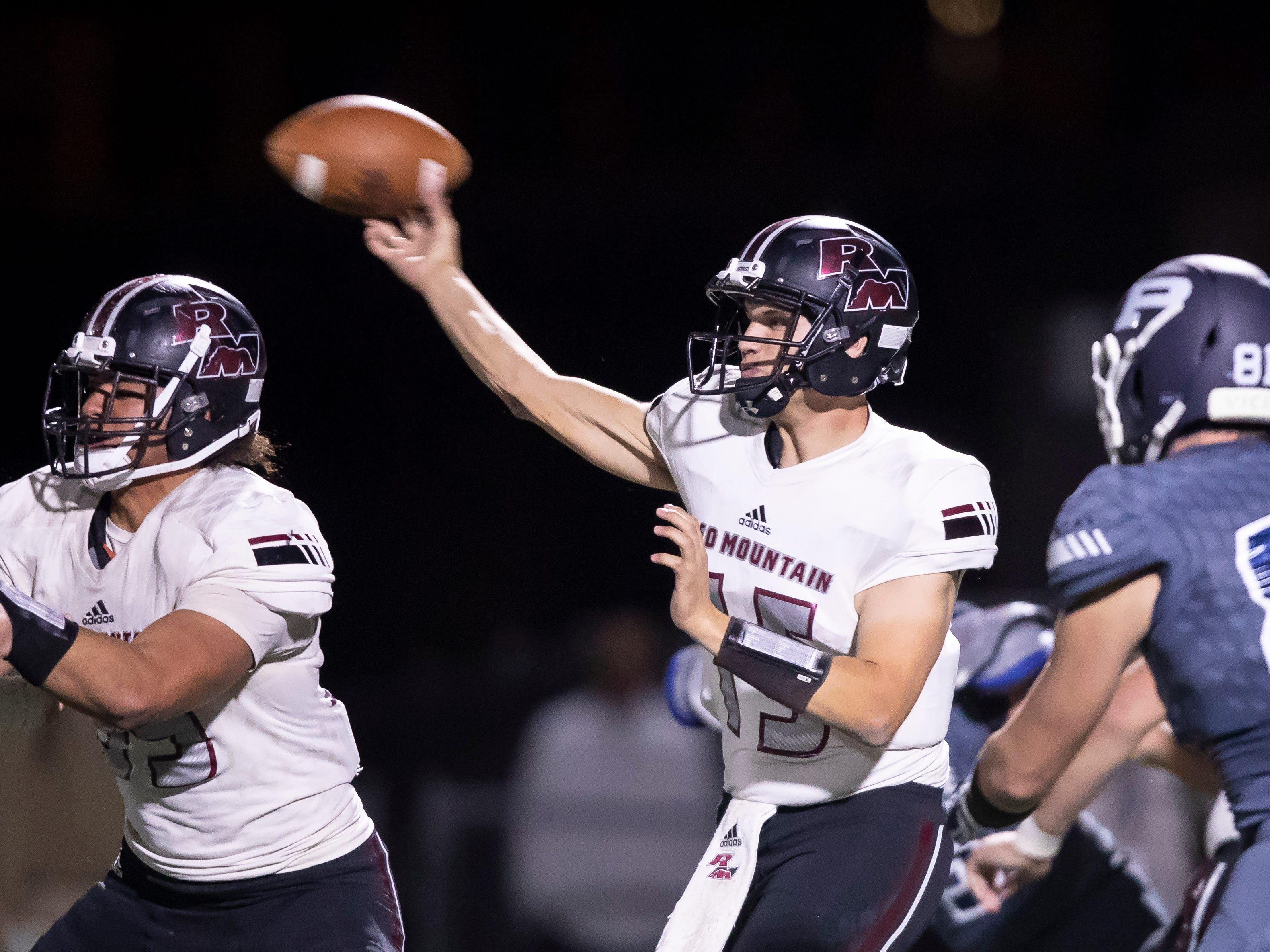 Senior quarterback Darren Smith (15) of the Red Mountain Mountain Lions throws a pass during the playoff game against the Pinnacle Pioneers at Pinnacle High School on Friday, November 9, 2018 in Phoenix, Arizona. #azhsfb