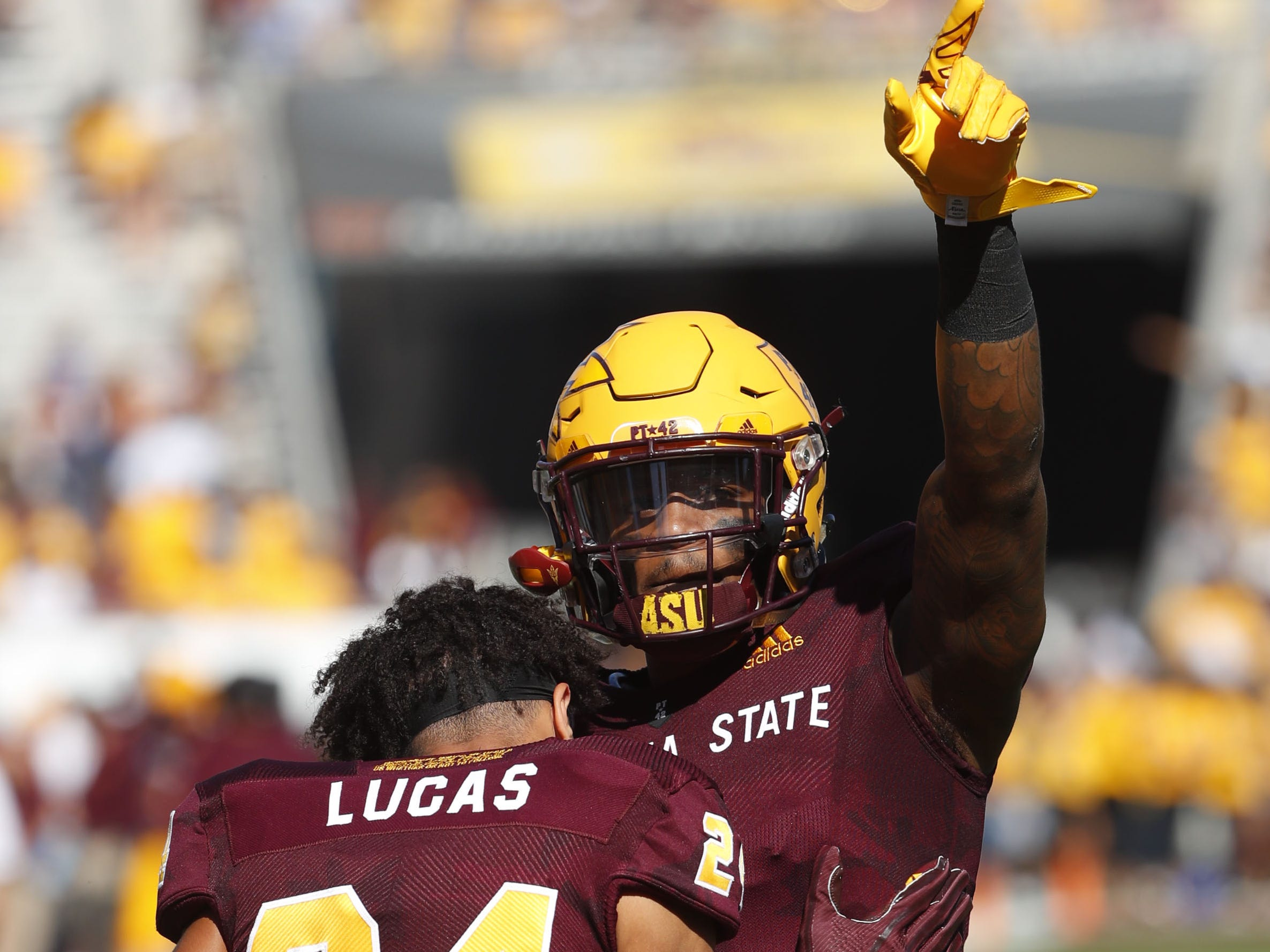 ASU's N'Keal Harry (1) points to the crowd as he is embraced by Chase Lucas (24) before the last home game against UCLA at Sun Devil Stadium in Tempe, Ariz. on November 10, 2018.