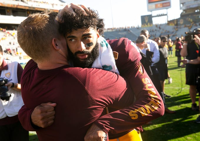 ASU quarterback Manny Wilkins receives a hug after ASU's 31-28 win over UCLA in the PAC-12 college football game at Sun Devil Stadium in Tempe on Saturday, November 10, 2018. This is the last game at Sun Devil Stadium for Wilkins.