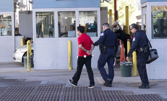 U.S. Customs and Border Protection officials arrest a man at Nogales Port of Entry, Dennis DeConcini Crossing on Nov. 9, 2018.