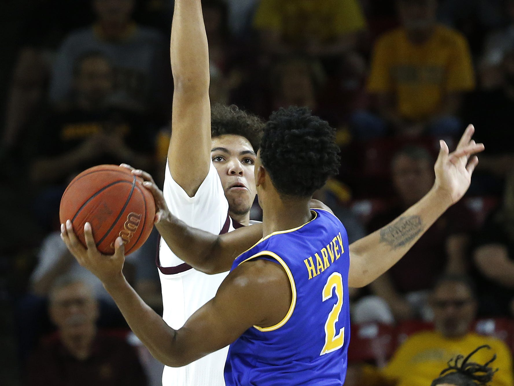Arizona State's Taeshon Cherry (35) defends McNeese State's James Harvey (2) during the first half at Wells Fargo Arena in Tempe, Ariz. on November 9, 2018.