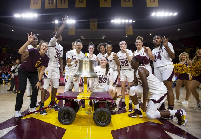The Arizona State Sun Devils ring the victory bell following their win against the Incarnate Word Cardinals at Wells Fargo Arena on Tuesday, November 6, 2018 in Tempe, Arizona.