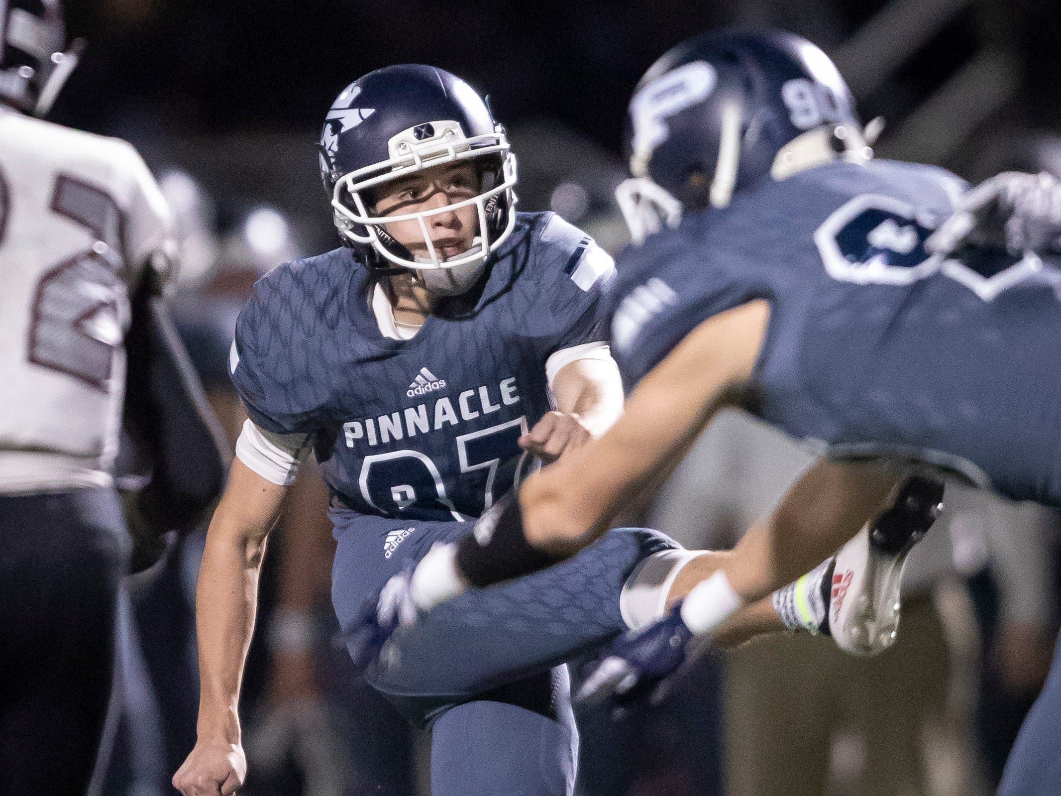 Junior kicker Dominic Persi (87) of the Pinnacle Pioneers kicks a field goal during the playoff game against the Red Mountain Mountain Lions at Pinnacle High School on Friday, November 9, 2018 in Phoenix, Arizona. #azhsfb