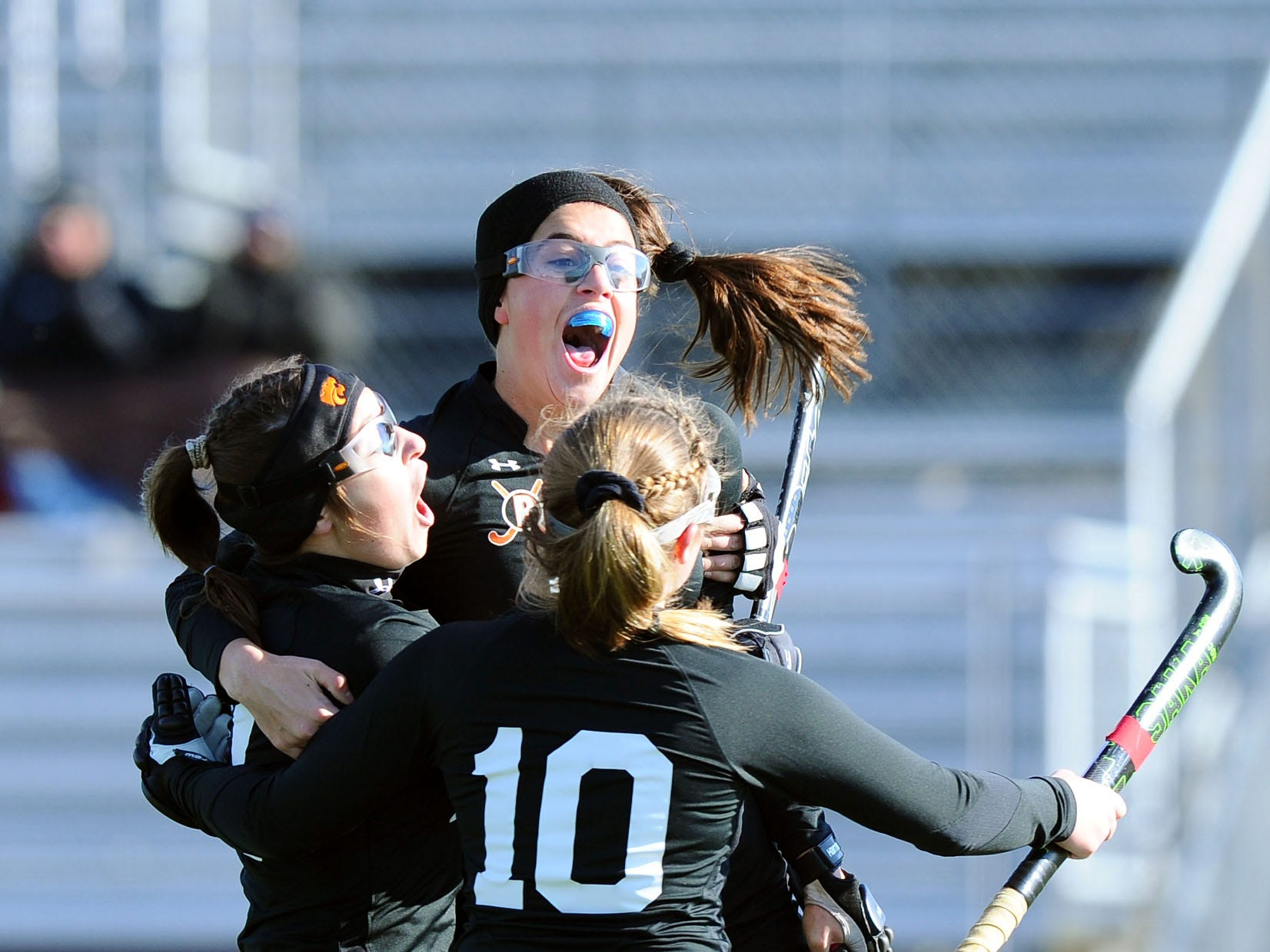 Palmyra's Mia Julian(18) is lifted into the air after scoring the game-winning goal in OT by her teammates Lauren Wadas (21) and Alexa Derr (10).