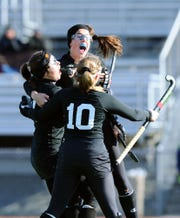 Palmyra's Mia Julian, top, is lifted into the air after scoring the game-winning goal in OT by her teammates Lauren Wadas (21) and Alexa Derr (10) during a state playoff win over Villa Maria last season.