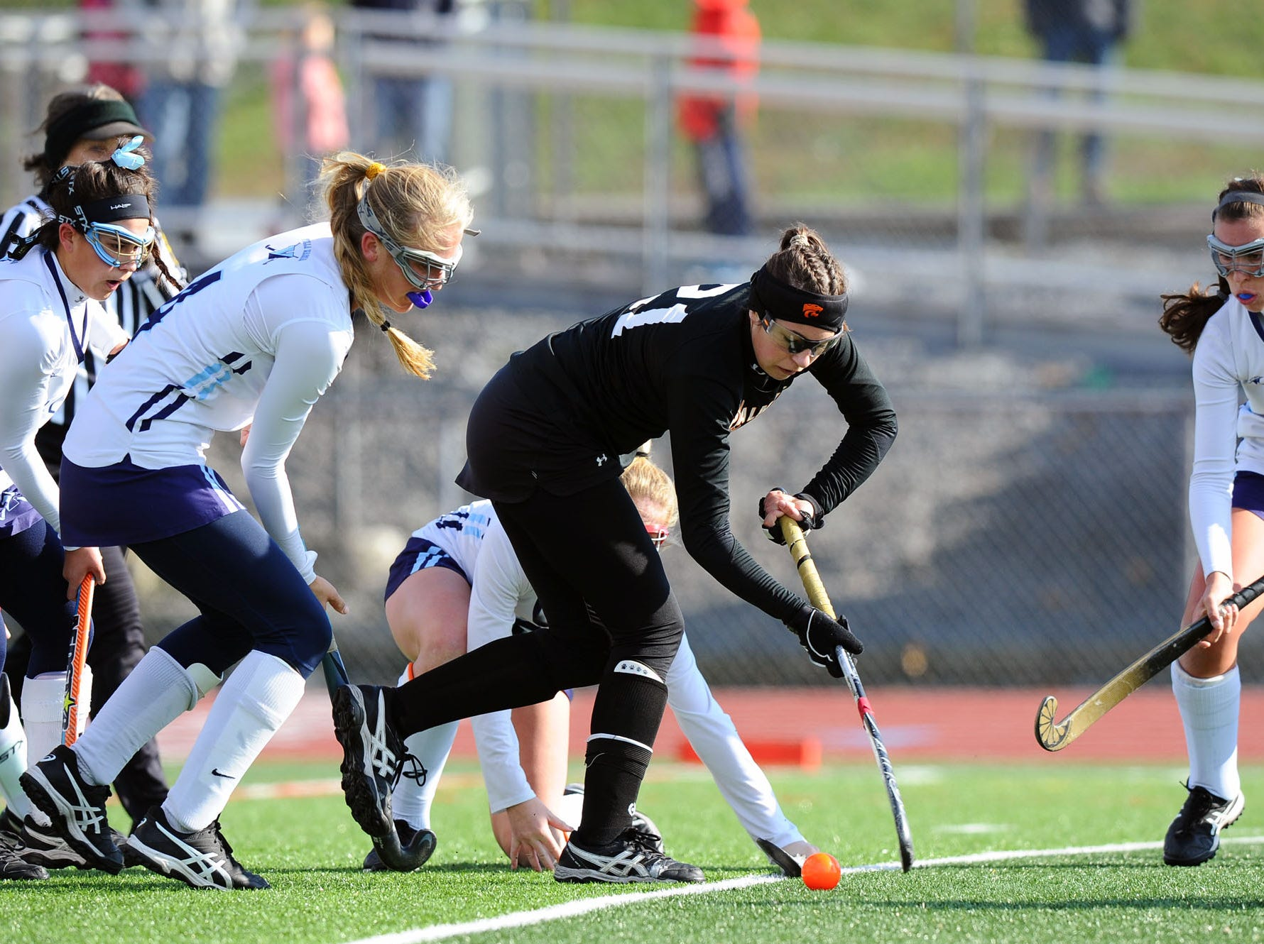 Palmyra's Lauren Wadas (21) tries to control the ball in front of the Villa Maria goal as Adele Iacobucci (4) defends.