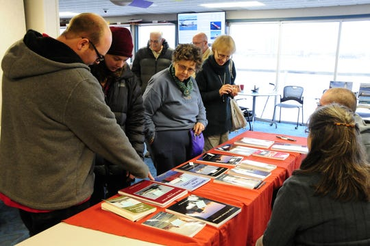 People check out the books at the Boats and Books sale on Saturday, Nov. 10, 2018 at the Great Lakes Maritime Center in Port Huron.