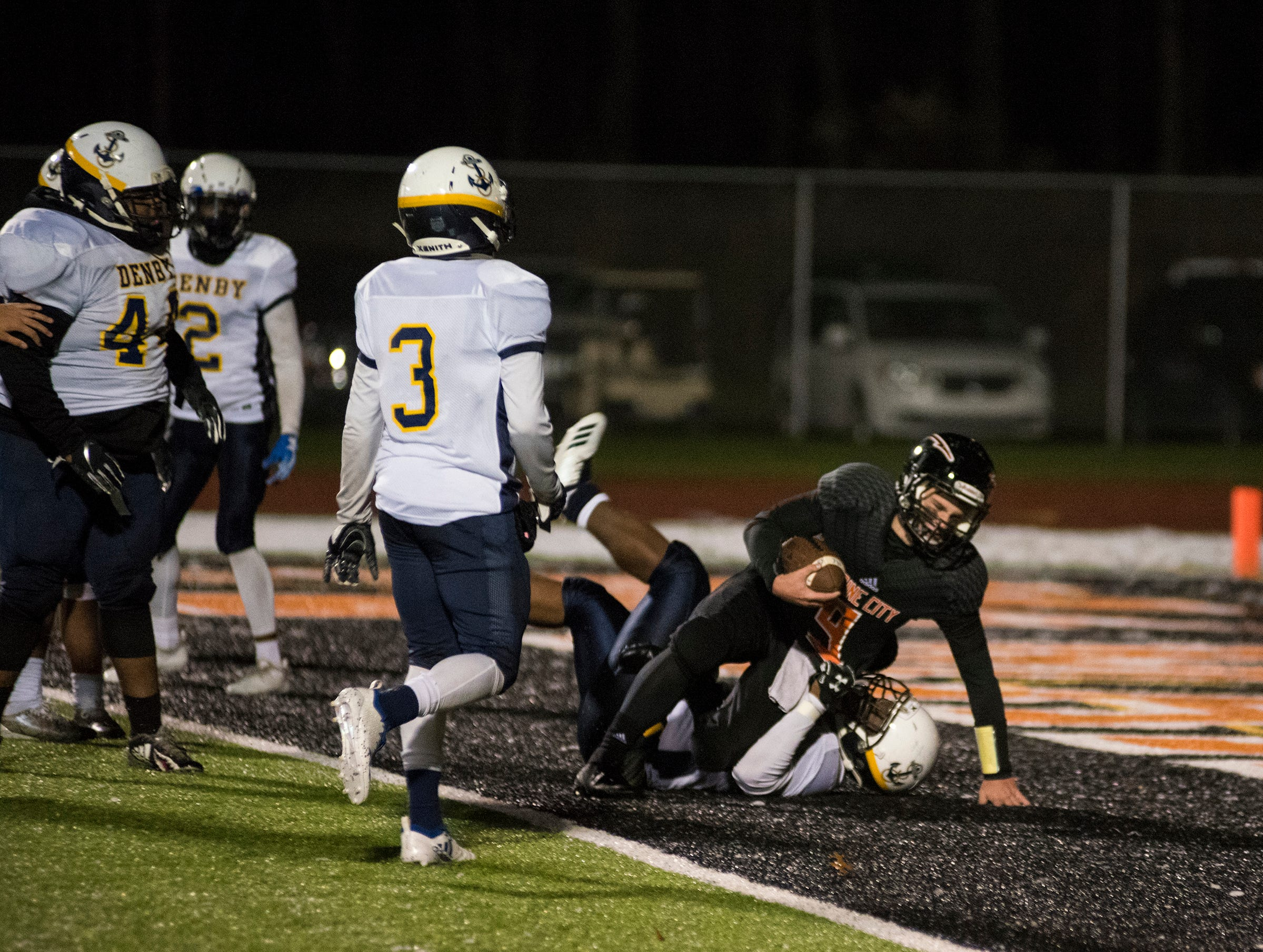 Marine City High School quarterback Colby Walker (9) is brought down inside the end zone in overtime during the MHSAA Division 5 regional championship game against Detroit Denby Tech Friday, Nov. 9, 2018 at East China Stadium.