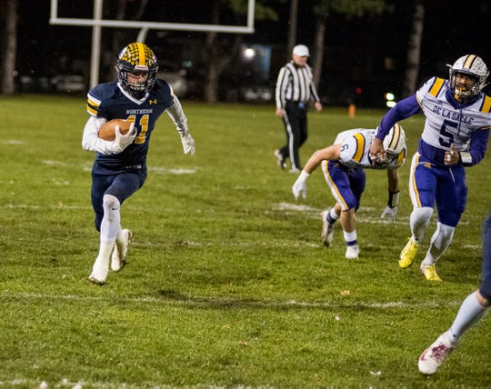Port Huron Northern High School wide receiver James DeLong (11) runs the football during the first quarter of the MHSAA Division 2 regional championship game against Warren De La Salle Friday, Nov. 9, 2018 at Memorial Stadium.