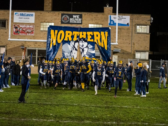 The Port Huron Northern High School Huskies storm the field before the MHSAA Division 2 regional championship game against Warren De La Salle Friday, Nov. 9, 2018 at Memorial Stadium.