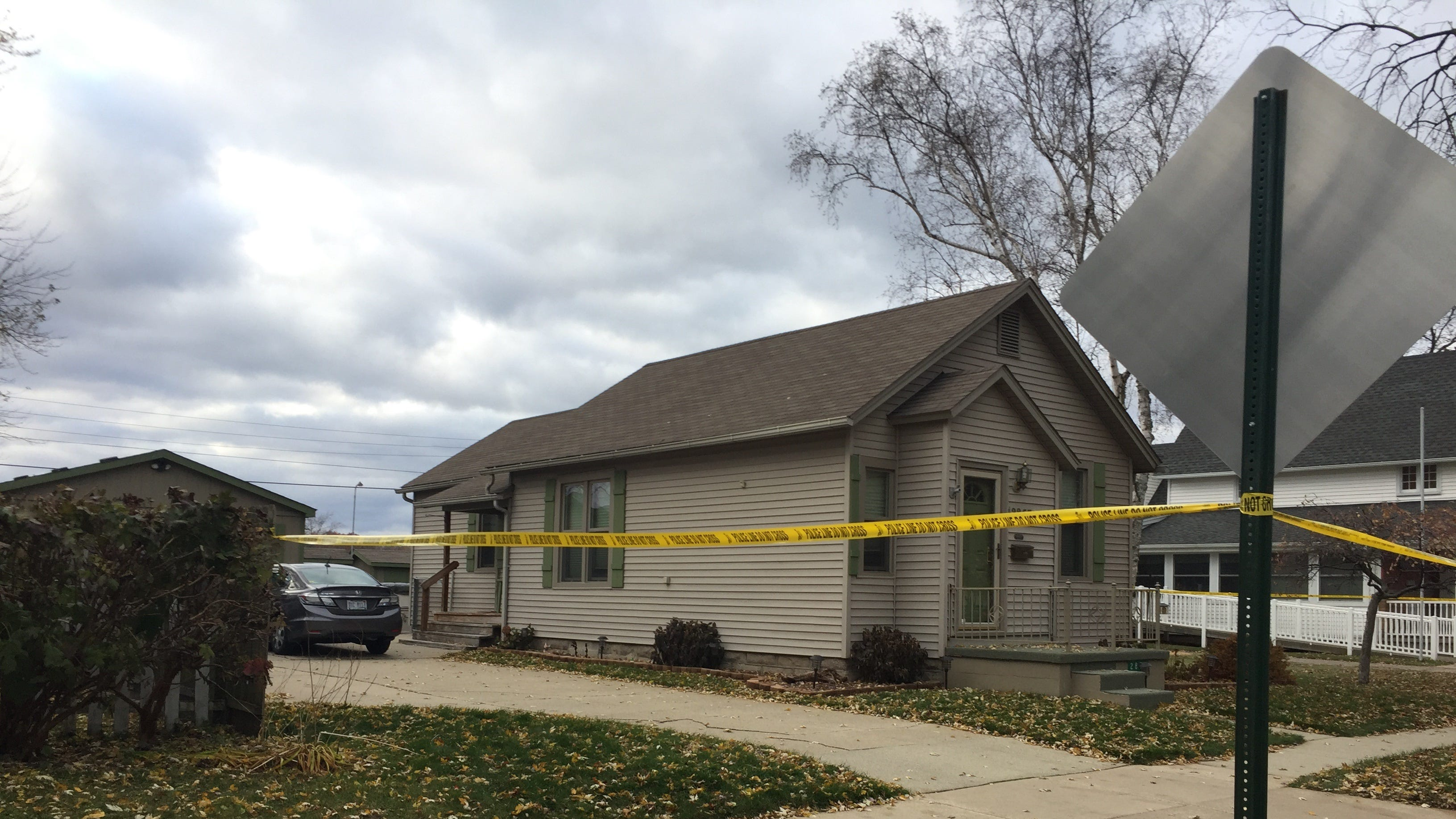 Evidence tape restricts access to a home on Stone Street in Port Huron where a mother and daughter were found dead.
