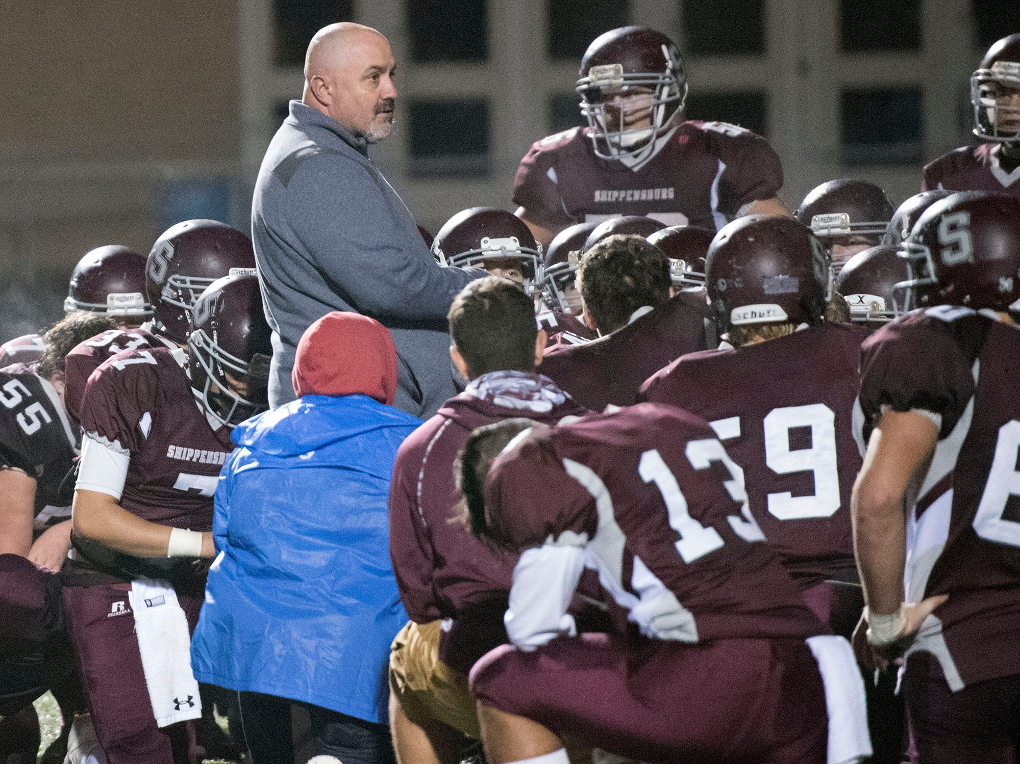 Coach Eric Foust meets with his players after the game. York High defeated Shippensburg 22-6  in the the quarterfinals of PIAA 5A District 3 football playoffs on Friday, Nov. 9, 2018 at Trojan Stadium.
