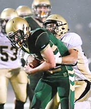 Delone Catholic's Joe Hernandez, back, looks to take down York Catholic's Mitchell Galentine during the District 3 Class 2-A football title game at South Western High School in Hanover last season. Galentine is among the key returning players for the Irish this season. Dawn J. Sagert photo
