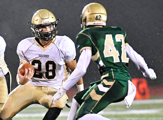Delone Catholic's Joe Hernandez, left, looks to get past York Catholic's Benjamin Nelson during District 3, Class 2-A football title game action at South Western High School in Hanover, Friday, Nov. 9, 2018. York Catholic would win the game 28-21 in overtime. Dawn J. Sagert photo