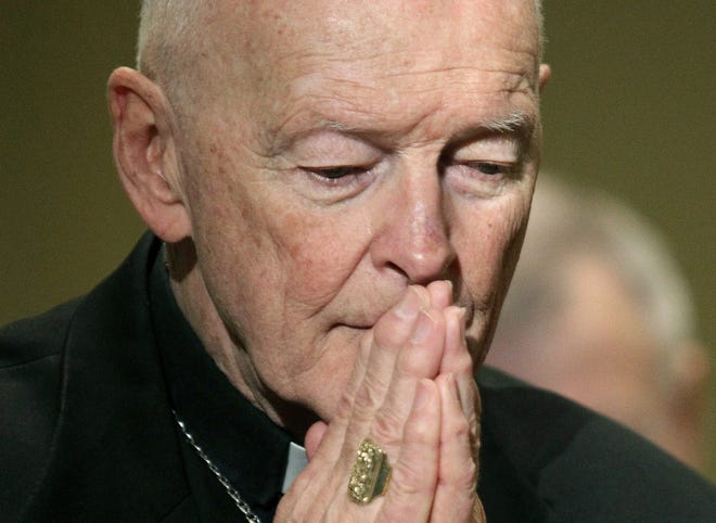 FILE - In this Nov. 14, 2011, file photo, then-Cardinal Theodore McCarrick prays during the United States Conference of Catholic Bishops' annual fall assembly in Baltimore. As U.S. Catholic bishops gather for an important national assembly, the clergy sex abuse crisis dominates their agenda. But it's only one of several daunting challenges facing the nation's largest religious denomination. While federal and state law enforcement agencies widen their investigations of abuse, the church finds itself with ever fewer priests and nuns in service.  (AP Photo/Patrick Semansky, File)