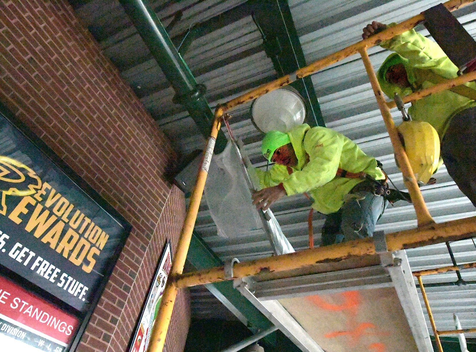 Foundation Building Materials employees William Sanders, left, and Silas Yashinski, cover pipings before spraying insulation at PeoplesBank Park Friday, Nov. 9, 2018. Several upgrades to the stadium are underway in time for the 2019 season. Bill Kalina photo