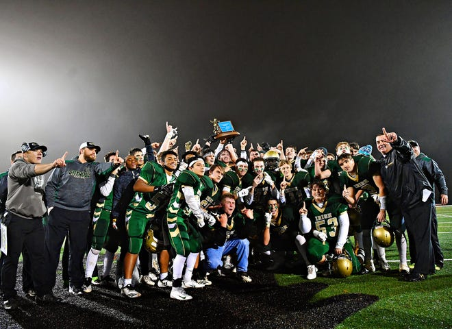 York Catholic celebrates a 28-21 victory over Delone Catholic, securing the District 3 Class 2-A football title at South Western High School in Hanover, Friday, Nov. 9, 2018. Dawn J. Sagert photo