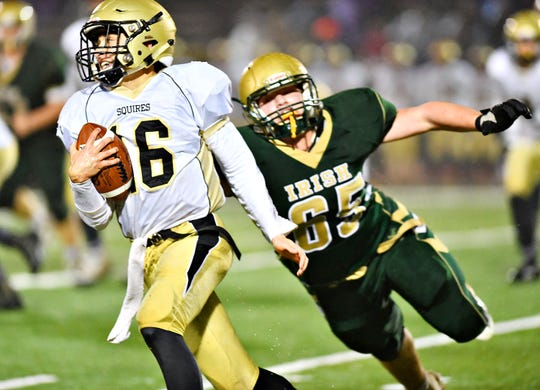 Delone Catholic's Evan Brady, left, pulls away from York Catholic's Jarred Kohl during District 3, Class 2-A football title game action at South Western High School in Hanover, Friday, Nov. 9, 2018. York Catholic would win the game 28-21 in overtime. Dawn J. Sagert photo