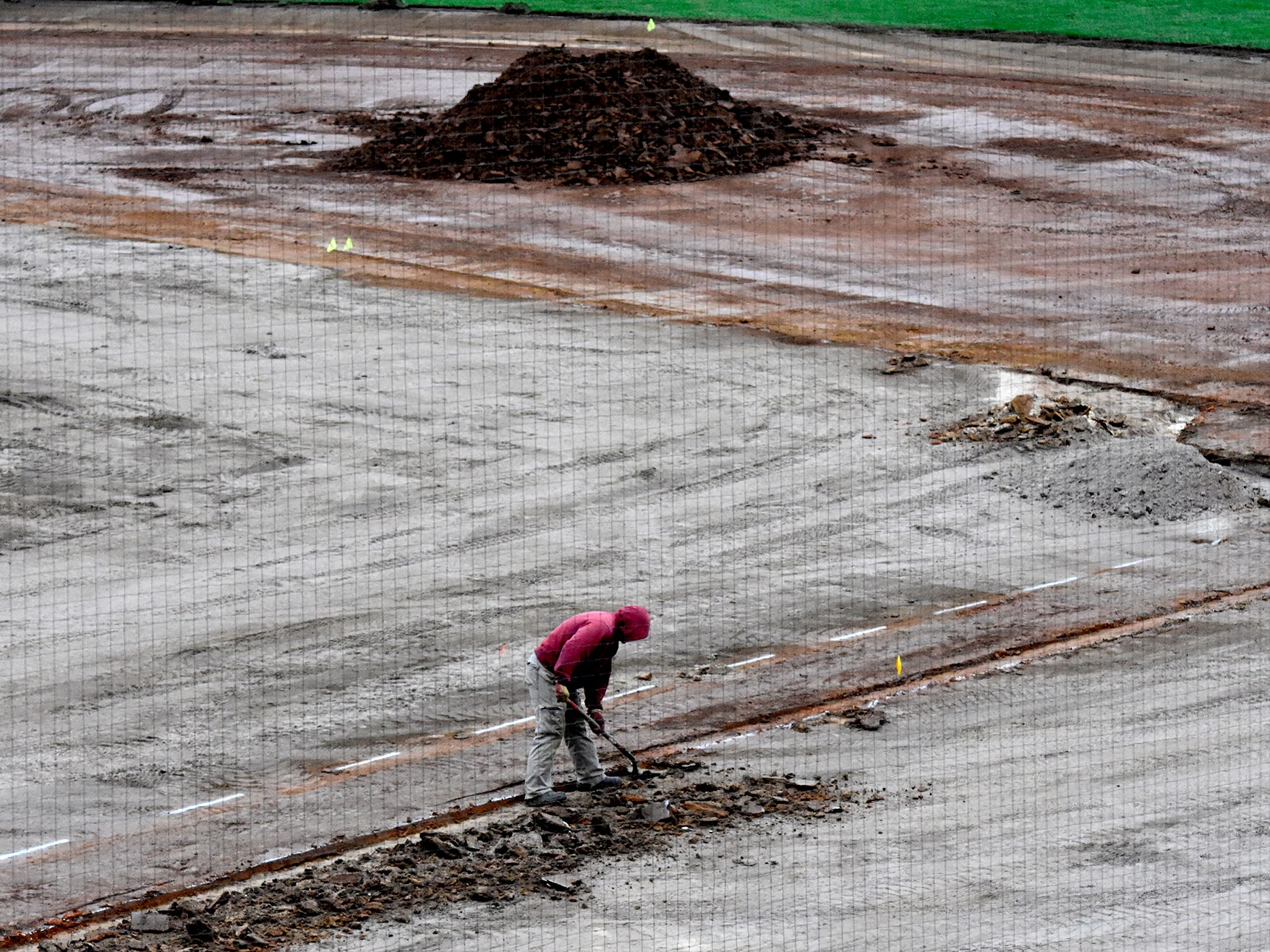 Jose Us of Hummer Sports Turf, Lancaster,  removes dirt along the first base line at PeoplesBank Park Friday, Nov. 9, 2018. The infield is being replaced this year. Bill Kalina photo